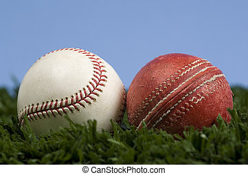 cricket ball and baseball on grass with blue sky - illustration of the way things change.  Baseball is an evolution of cricket