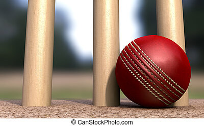 Cricket Ball At Base Of Wickets - A red leather cricket ball...