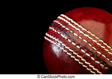 Cricket Ball - Cricket ball in close-up, over black...