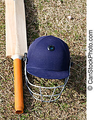 cricket bat and helmet on the field