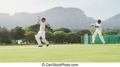 Cricket player catching the ball and destroying the stamps...