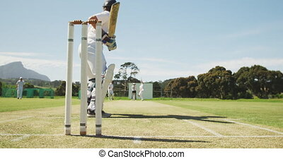 Cricket player missing the ball on a pitch - Low angle rear ...
