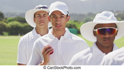 Cricket players looking at the camera before training