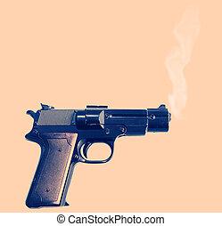 crime gun smoke - smoking gun, evidence of a crime. pistol...