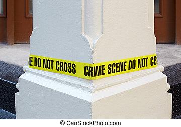 Crime scene do not cross, yellow police tape around a white column