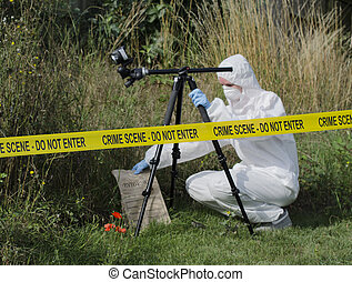 Crime Scene Examination - Forensic scientist checking for...