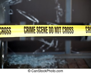 Crime Scene Marked with Yellow Tape - Yellow tape blocks off...