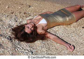 Crime scene on the beach - young woman lying dead or drunk ...