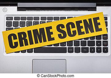 Crime Scene Tape On Laptop Keypad