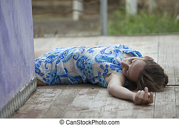 unconscious woman in short dress lying on the ground