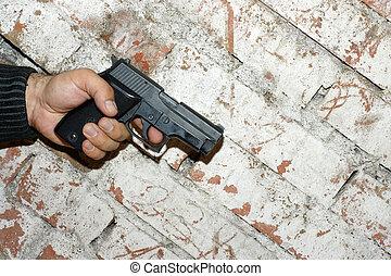 Crime Story Concept - Crime concept. Hand holding a pistol...