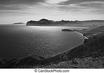 Crimea landscape with mountain and sea bay, black and white