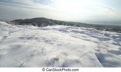 Crimean winter mountain landscape. Snow trail on a hill in Crimea