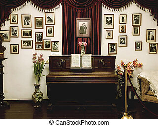 Crimea/Russia - August 2020: Piano and pictures in Chekhov's dacha