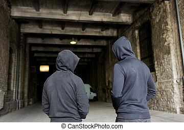 addict men or criminals in hoodies on street - criminal...