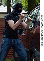 Criminal breaks into car