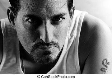 Criminal - Closeup portrait of a serious dangerous looking ...