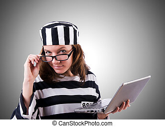 Criminal hacker with laptop against gradient