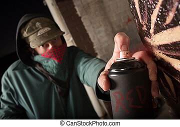 Criminal Holding Up Spray Can - Black spray paint can held ...