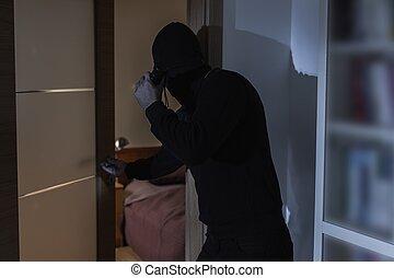 Criminal in black clothes