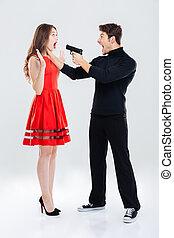 Criminal man choking and threatening with gun to woman