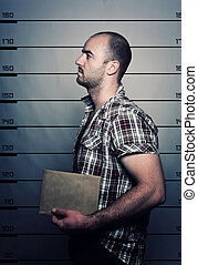 criminal portrait - classic police photo of arrested...