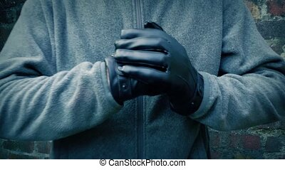 Tough man punching hands and walking towards camera