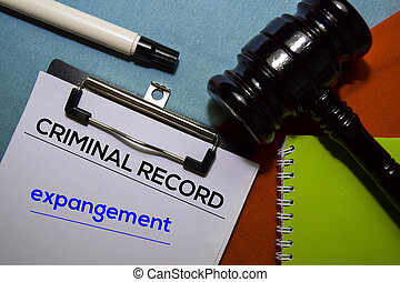 Criminal Record and Expangement text on Document form and Gavel isolated on office desk.