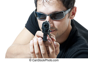Criminal theme - man in sunglasses with gun