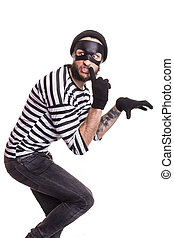 criminal, thief, robber, crime - A thief with mask quietly...