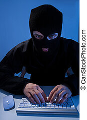 Criminal Using Computer To Hack Online Account