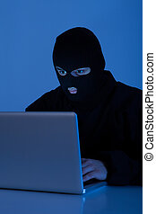 Criminal Using Laptop To Hack Online Account