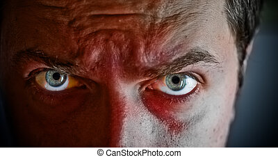 Criminal with blood on his face - Close-up on criminal with...