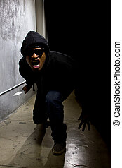 Criminal With Knife Hiding in the Alleys - hooded criminal...