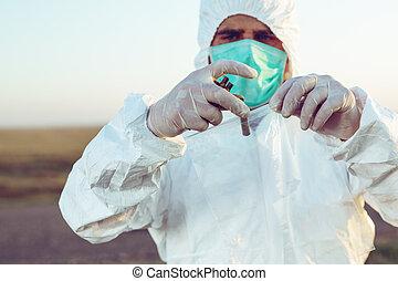 Criminologist investigates a crime scene.