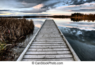 Crimson Lake Alberta Canada boat dock sunset