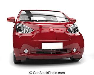 Crimson red metallic small urban modern electric car - front closeup