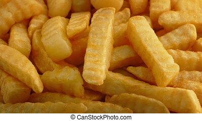 Crinkle-Cut Fries Rotating Closeup - Closeup of crinkle-cut...