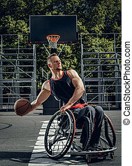 Cripple basketball player in wheelchair plays basketball.