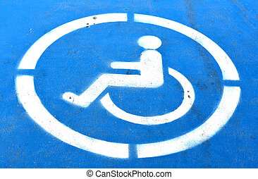 Cripple wheelchair sign on the blue road in the hospital