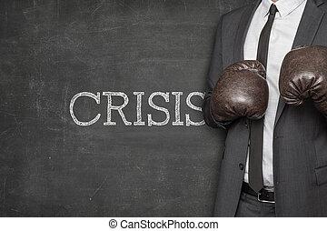 Crisis on blackboard with businessman