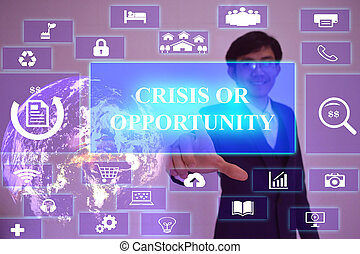 CRISIS OR OPPORTUNITY concept  presented by  businessman touching on  virtual  screen ,image element furnished by NASA