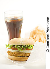 crisp chicken burger with tomato onion cheese lettuce ...
