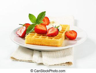 Crisp waffle with fresh strawberries