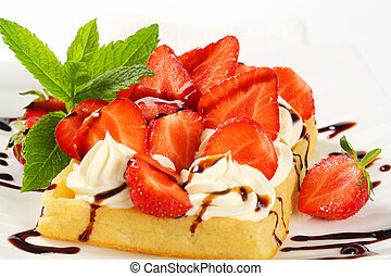 Crisp waffle with strawberries and cream - Belgian waffle...