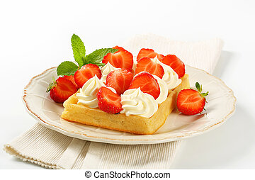 Crisp waffle with  strawberries and cream