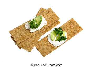 crispbread with curd cheese with cucumber and parsley