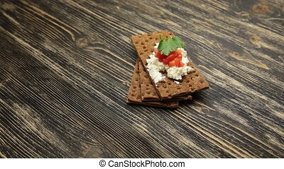Crispbread with soft cottage cheese and red pepper rotate...