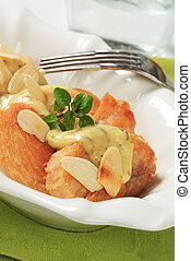 Crispy chicken breast with cream sauce and almonds