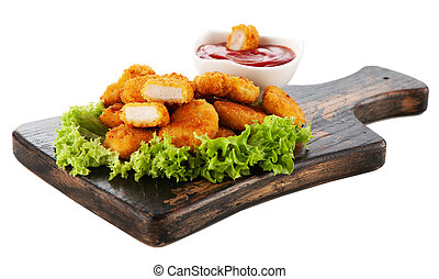 Crispy chicken nuggets with lettuce and ketchup